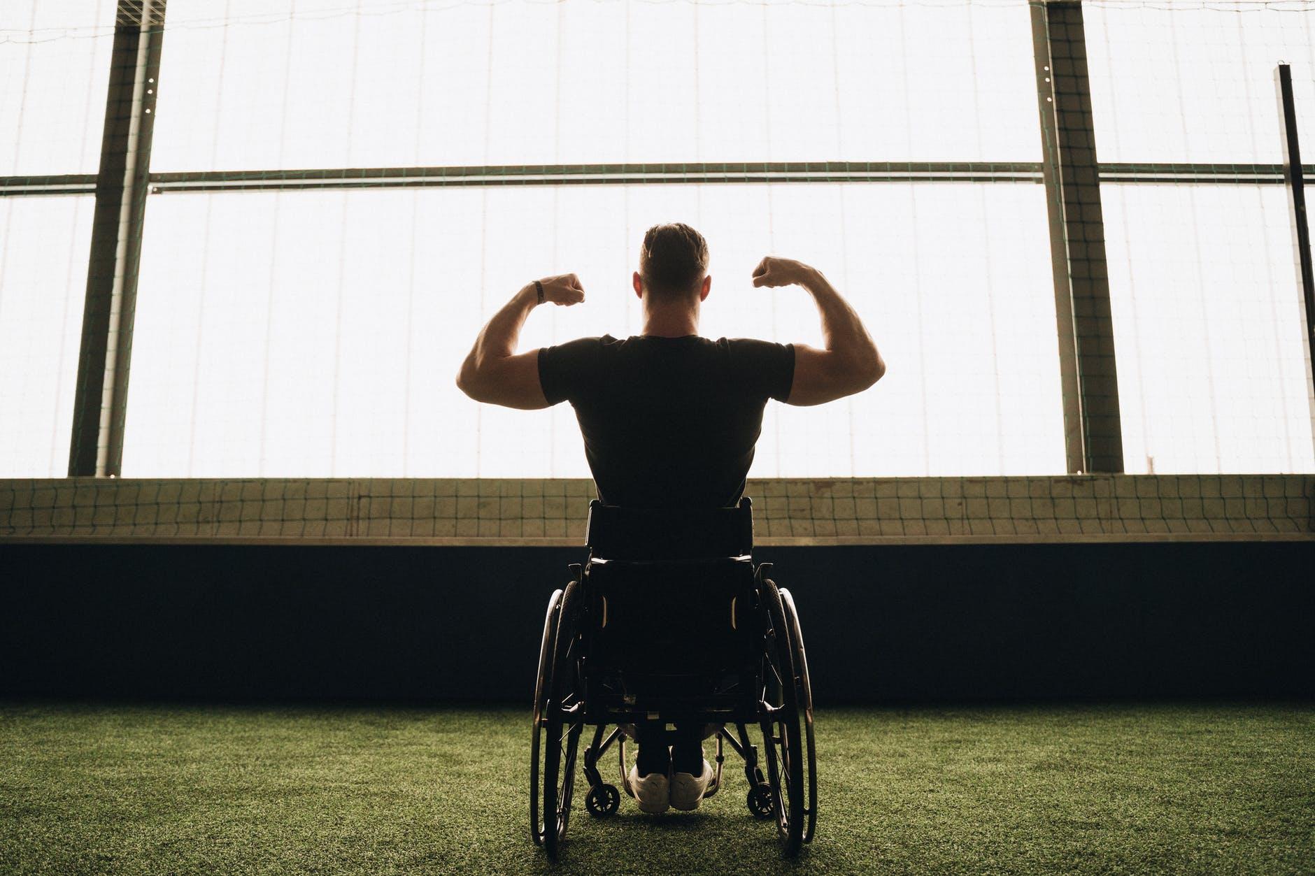 man in black t shirt sitting on black wheelchair